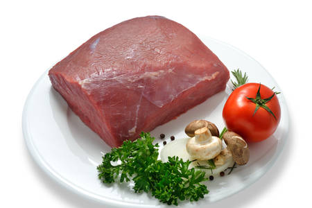 Raw meat ready to be cooked isolated on white   beef   photo