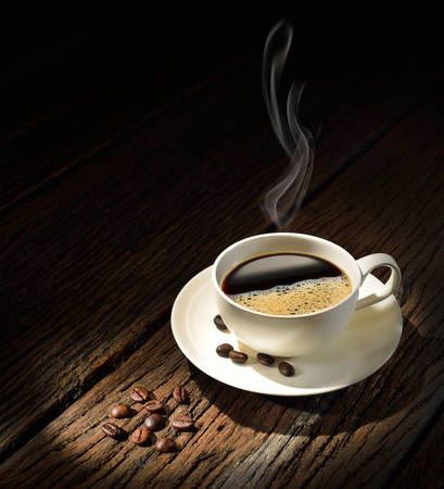 Coffee cup and coffee beans on old wooden background photo