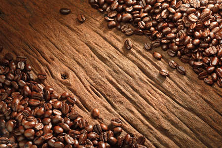Top view of coffee beans on old wooden background Banco de Imagens