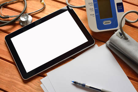 medical device: Tablet pc computer with stethoscope and automatic blood pressure Stock Photo