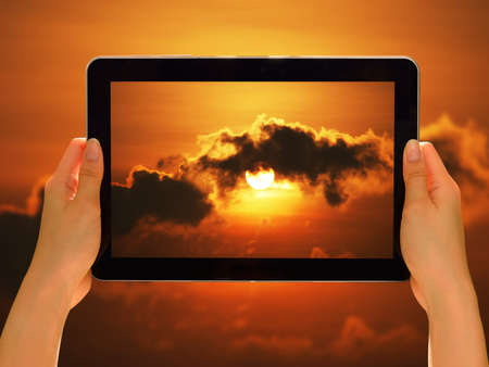 woman tablet: Woman hands holding tablet pc taking photo in nature