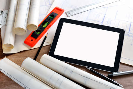 engineering plans: Tablet computer with architectture and construction tools and blueprints
