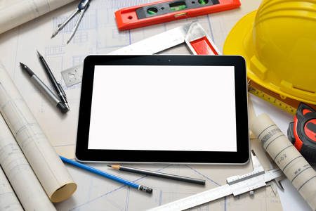 construction: Tablet computer with architectture and construction tools and blueprints
