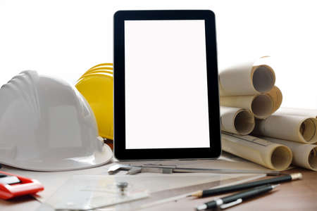 Tablet computer with architectture and construction tools and blueprints photo