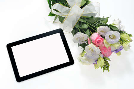 pc screen: Tablet computer and beautiful bouquet of flowers isolated on white