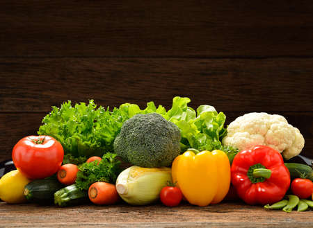Vegetables and fruits on old wooden background