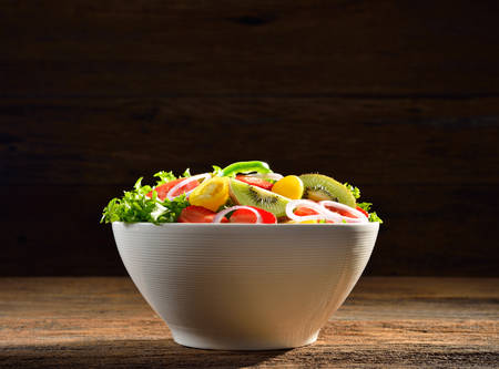 corn salad: Fruit and vegetable salad in a bowl on wooden table
