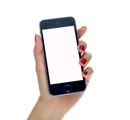 Vrouwelijke hand met mobiele telefoon geïsoleerd op wit Stockfoto