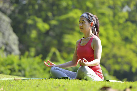 middle age women: Middle aged woman doing yoga posture outdoor Stock Photo