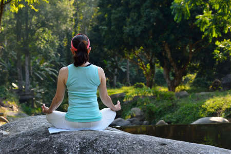 meditation pray religion: Middle aged woman practicing yoga meditation outdoor
