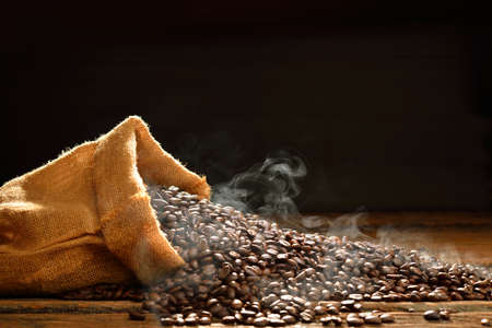 Coffee beans with smoke in burlap sack,This photo is available without smoke