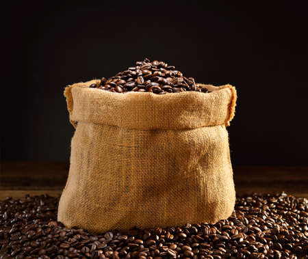 Coffee beans in burlap sack, This photo is available with smoke Banque d'images