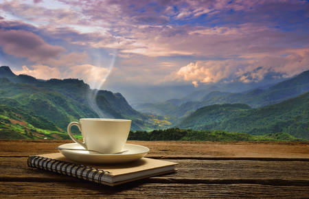 Morning Cup Of Coffee With Mountain Background At Sunrise Stock ...