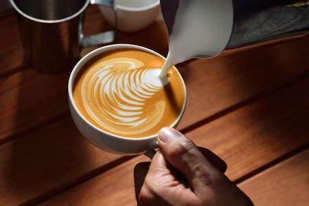 leaf shape: Making of cafe latte art  Leaf shape Stock Photo