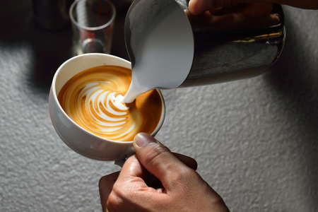 Making of cafe latte art leaf shape Stock Photo