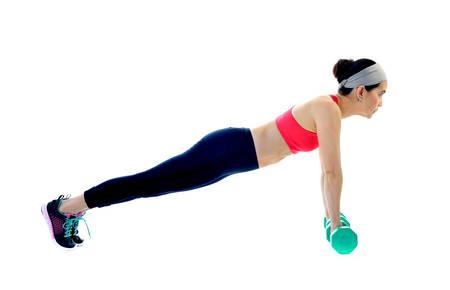 beautiful body: Middle aged woman exercising isolated on white background
