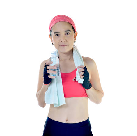 women sport: Middle aged woman with exercise towel and water