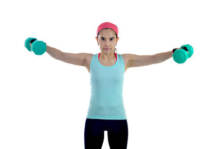 mujer alegre: Middle aged woman exercising with dumbbells isolated on white background Foto de archivo