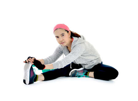 women sport: Middle aged woman stretching after exercising isolated on white background