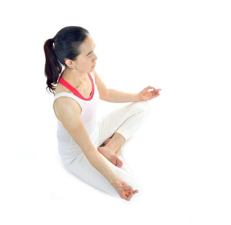 meditation isolated white: Middle aged woman practicing yoga meditation isolated on white background