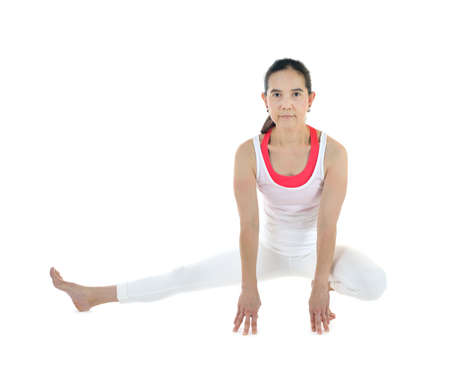 Middle aged woman exercising and stretching isolated on white background