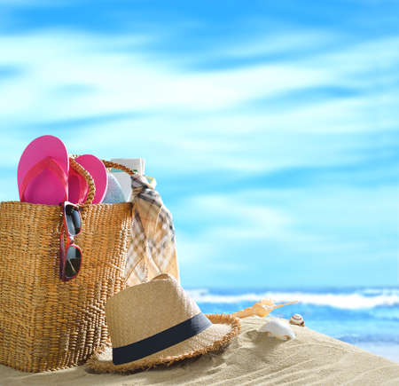 sandy beach: Beach accessories on sandy beach with blue sea and sky background Stock Photo