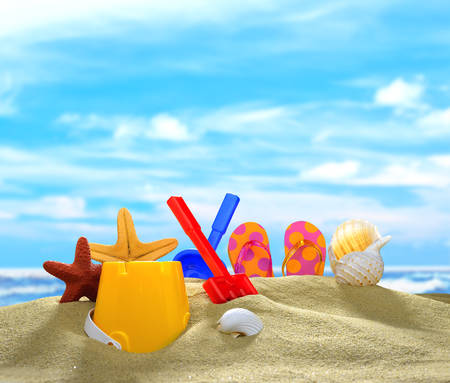 flip flops: Childrens flip flops with beach toys and seashells on the sandy beach Stock Photo
