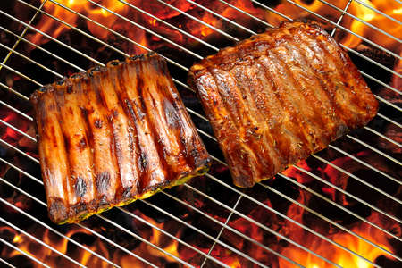 barbecue grill: Grilled pork ribs on the flaming grill Stock Photo