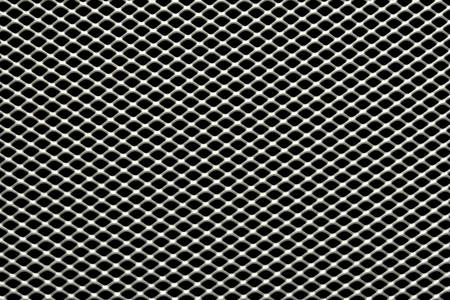 trapezoid: Background sheet of metal covered with lines of trapezoid holes Stock Photo