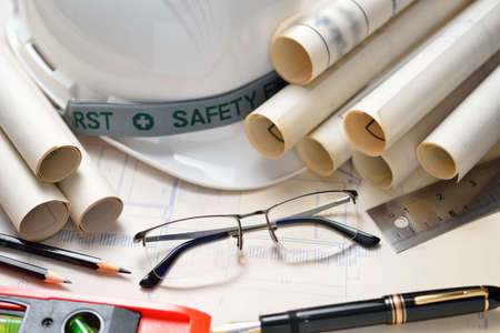 Businessman eyeglasses with construction plans at construction site