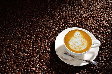 coffee crop: Cup of latte art, coffee and coffee beans Stock Photo