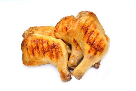 thighs: muslos de pollo asado aislado en el fondo blanco