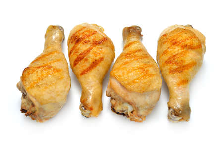 cooked: Grilled chicken legs isolated on white background