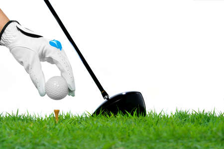 games hand: Hand hold golf ball with tee isolated on white background
