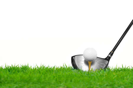 Golf ball on tee in front of driver isolated on white background