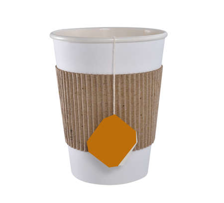 Paper cup of tea with tea bag (blank label) isolated on white background
