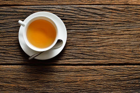 tea table: Top view of a cup of tea on wooden table Stock Photo