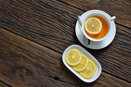 Top view of cup of tea with lemon on wooden table Stock Photo
