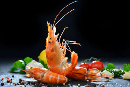 Cooked shrimps,prawns with seasonings on stone background
