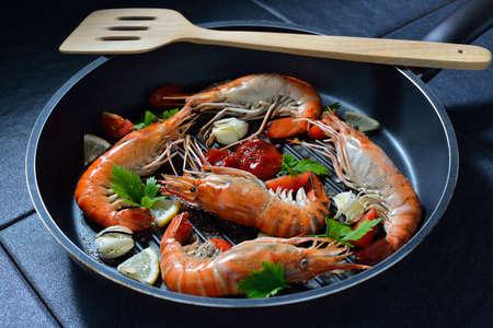 prawn: Cooked shrimps,prawns with seasonings in frying pan Stock Photo