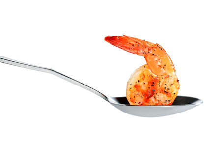 Cooked shrimp on spoon isolated on white background Stock Photo