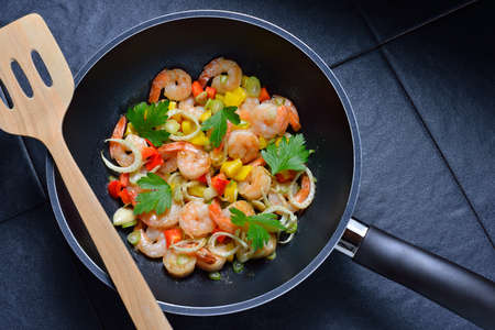 pan: Cooked shrimps,prawns with seasonings in frying pan Stock Photo