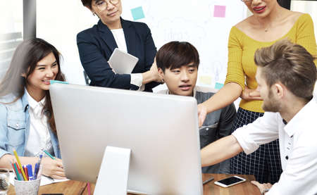 Group of businesspersons having different age in creative business discussing work in the office Stock Photo - 75192983