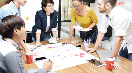 Group of businesspersons having different age in creative business discussing work in the office Stock Photo