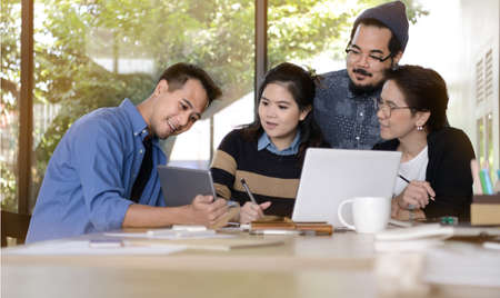 new age: Group of business people having different age in creative business discussing work in the office Stock Photo