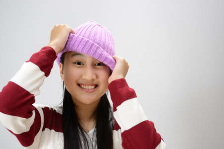 fashion: Beautiful happy smiling teenage girl over gray background