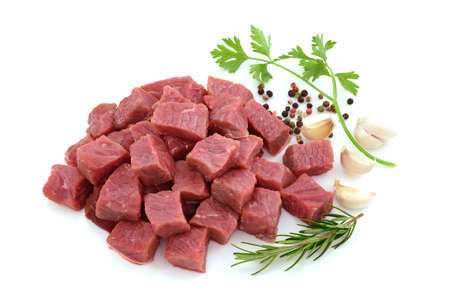 Raw meat, beef steak sliced in cubes isolated on white background Archivio Fotografico