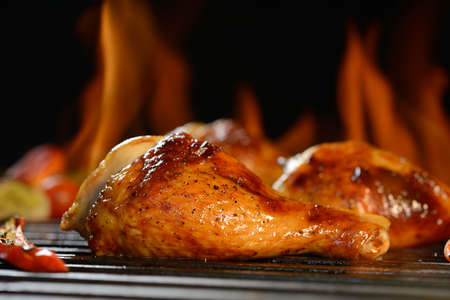 drumsticks: Grilled chicken leg on the flaming grill