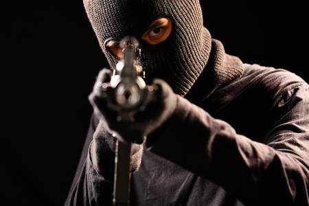 The Robber aiming rifle on black background