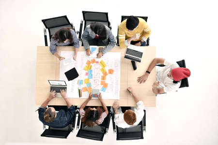 Top view of group of young businesspersons having discussion and sharing opinions in meeting at office Stock Photo - 105620257